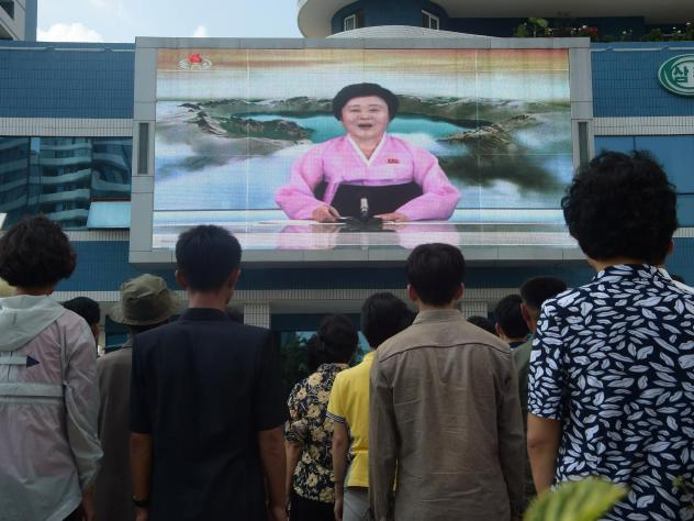 North Koreans watched a video screen in Pyongyang showing Korean Central Television news presenter Ri Chun Hee as she announced that the country had successfully tested a hydrogen bomb on Sept. 3, 2017.