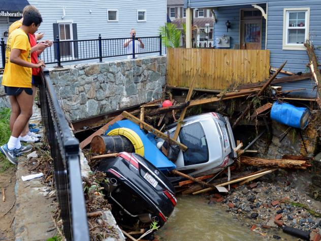 A road that washed out in Ellicott City, Md., during the second catastrophic flash flood to hit the city in two years.