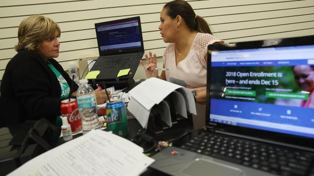 Margarita Mills (left), an insurance agent from Sunshine Life and Health Advisors, speaks with Daniela Morales as she shops for insurance under the Affordable Care Act at a store set up in the Mall of Americas, on Nov. 1, 2017, in Miami.