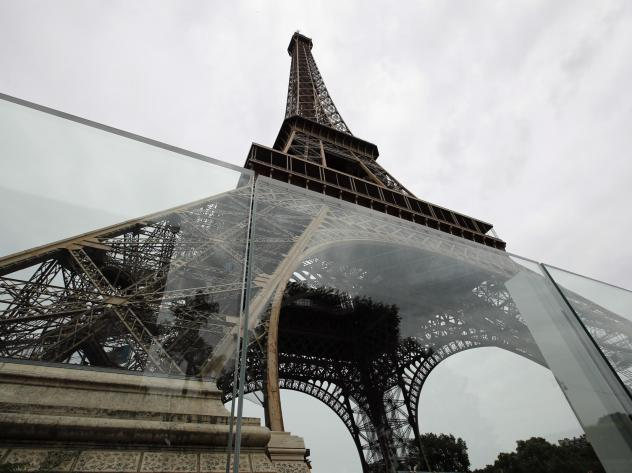 New metal fencing by the Eiffel Tower is meant to dissuade vehicles from ramming into the tourist site.