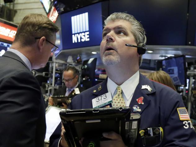 Trader John Panin works on the floor of the New York Stock Exchange on Tuesday. U.S. stock markets opened sharply lower as U.S.-China trade tensions grew.