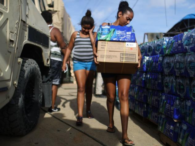 Puerto Rican residents received food and water from FEMA after Hurricane Maria, but many complained that some boxes were stuffed with candy and salty snacks, not meals.