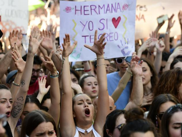 Demonstrators shout slogans Friday in Madrid, a day after a court ordered the release on bail of five men sentenced to nine years in prison for sexually abusing a young woman at Pamplona's bull-running festival.