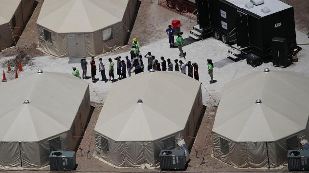 Children and workers are seen at a tent encampment on June 19, 2018 in Tornillo, Texas. The Trump administration is using the tent facility to house immigrant children separated from their parents.