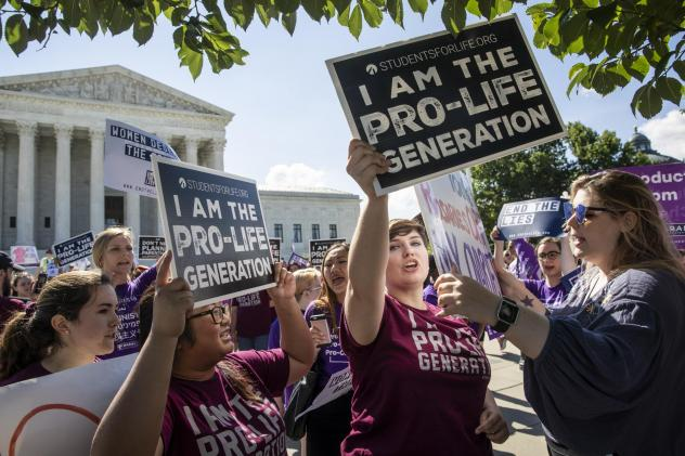 Anti-abortion-rights advocates demonstrate in front of the Supreme Court early Monday.