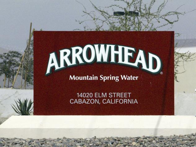 In a file photo from 2004, a sign at the entrance to the Arrowhead Mountain Spring Water Company bottling plant, owned by Swiss conglomerate Nestlé, on the Morongo Indian Reservation near Cabazon, Calif.