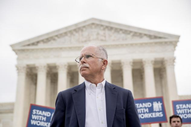 Plaintiff Mark Janus stands outside the Supreme Court after the court rules in a setback for organized labor that states can't force government workers to pay union fees.
