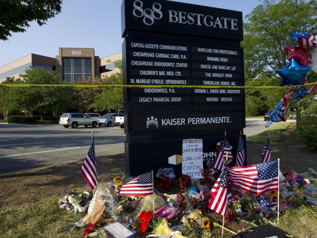 A makeshift memorial is seen outside the office building housing the Capital Gazette newsroom in Annapolis, Md., on Sunday.