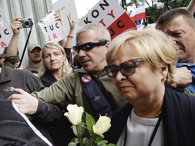 Crowds protest the forced retirement of the Supreme Court head and of some of its judges as part of a judicial overhaul before the Supreme Court building in Warsaw on Tuesday.