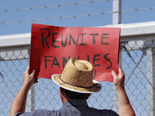 A protester outside a closed gate at the Port of Entry facility in Fabens, Texas.
