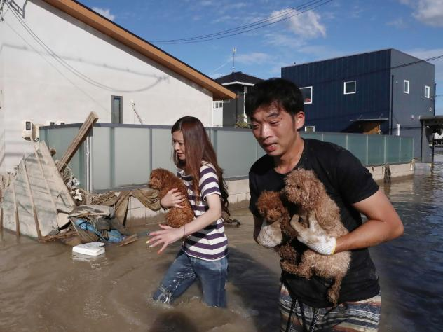 Japan's Self-Defense forces rescue people by boats from Mabi Memorial Hospital, which was isolated after flood damage.