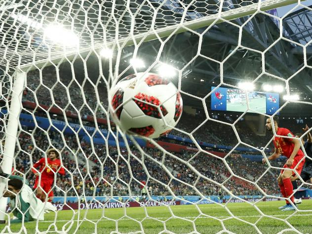 Belgium goalkeeper Thibaut Courtois, left, is beaten by a header from France's Samuel Umtiti for the opening goal during the semifinal match between France and Belgium at the 2018 soccer World Cup in St. Petersburg, Russia on Tuesday.