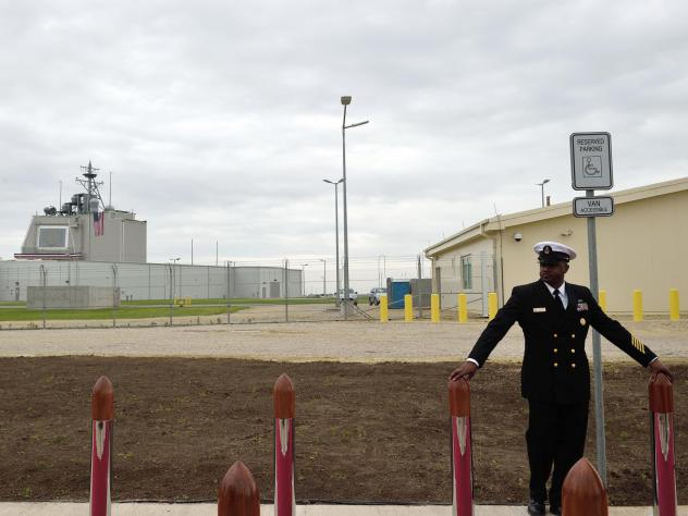 A U.S. Navy petty officer stands watch ahead of a ceremony inaugurating the U.S. anti-missile station Aegis Ashore Romania at Deveselu, Romania, in 2016. The station is part of NATO's anti-missile shield for Europe.