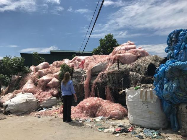 The single largest use for plastic is packaging, Jambeck says.  At this recycling center in southeast Asia, much of the waste is thin-film plastic that was once used to package single-use beverage containers.