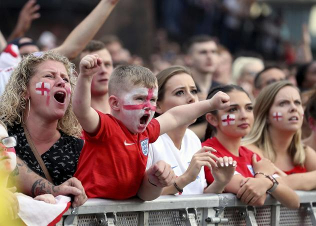 Fans cheer as they watch the 2018 World Cup semi final match between Croatia and England in Russia, at the Castlefield Bowl in Manchester, England on Wednesday.