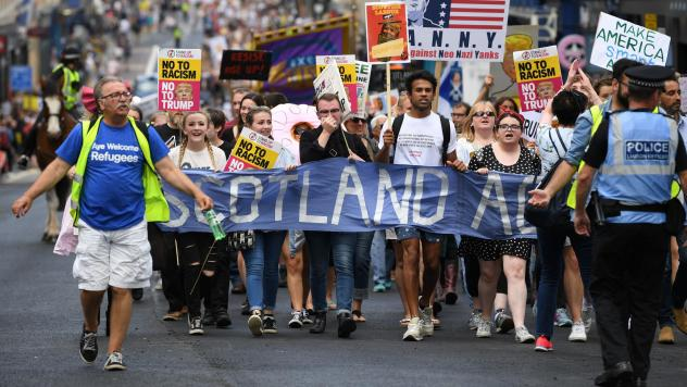 People in Edinburgh, Scotland, march in protest against President Trump during his first official visit to the U.K.