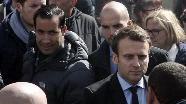 Emmanuel Macron (right) is flanked by his bodyguard, Alexandre Benalla (left) in Amiens, France. Benalla was filmed in May beating protesters during labor demonstrations.