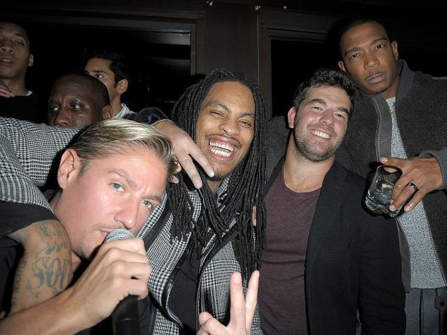 Billy McFarland (second from right), photographed with (L-R) promoter Matthew Asante and musicians Waka Flocka and Ja Rule in Manhattan in 2016.