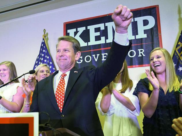 Georgia Republican gubernatorial runoff candidate Brian Kemp goes on stage to declare victory against Casey Cagle during an election night party, on Tuesday in Athens, Ga.