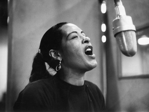 Jazz legend Billie Holiday at a recording session in 1957. Holiday's pioneering vocal style played with tempo, phrasing and pitch to stir hearts.