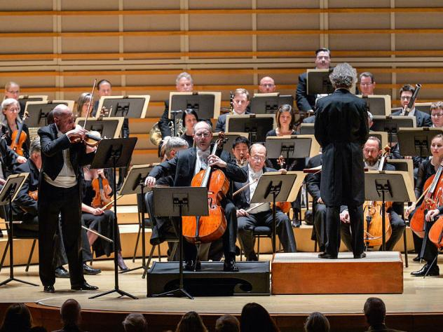 Violinist William Preucil (standing, left), performing with the Cleveland Orchestra in Miami in 2016.
