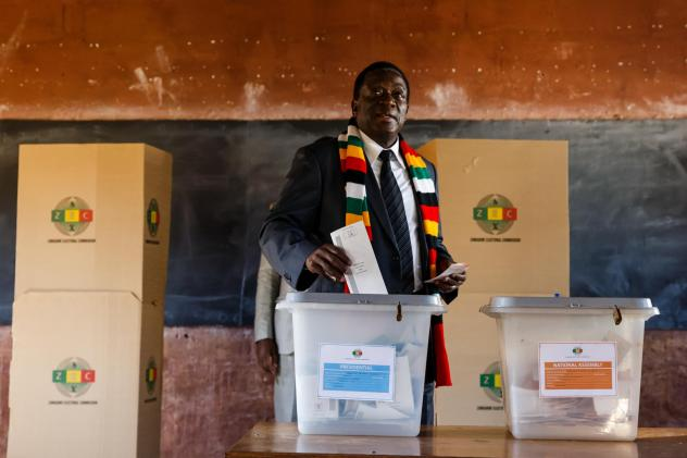 People line up early Monday morning at a polling station in the Harare suburb of Chitungwiza, where they waited to vote in Zimbabwe's first general elections since President Robert Mugabe's ouster.