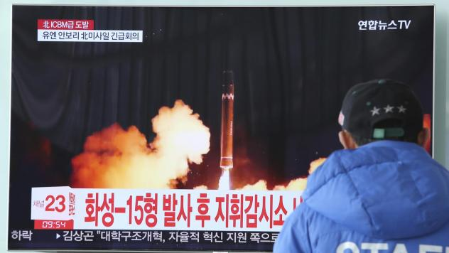 A man watches a TV screen showing what the North Korean government calls the Hwasong-15 intercontinental ballistic missile, at the Seoul Railway Station in Seoul, South Korea, in November.