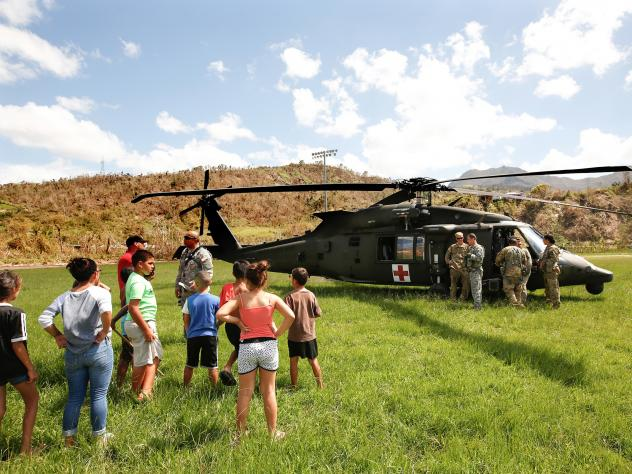 In the mountain town of Juyaya, Puerto Rico, last October, children watched as U.S. Army helicopters brought a team of physicians to assess the medical needs of the local hospital and residents. Going forward, health economists say, the U.S. territory wi