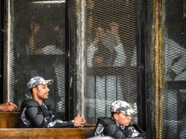 In this March 2015, photo, Mohamed Soltan is pushed by his father Salah during a court appearance in Cairo. Egyptian officials freed Soltan May 30, 2015. He had been sentenced to life in prison on charges of financing an anti-government sit-in and spread