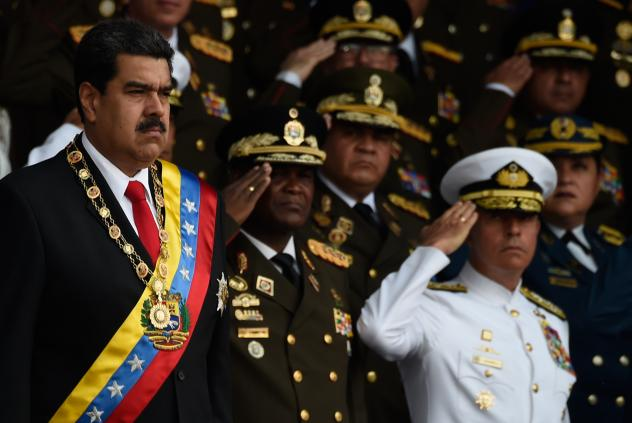 """Venezuelan President Nicolas Maduro, left, survived an """"attack"""" during a ceremony to celebrate the 81st anniversary of the National Guard in Caracas on Saturday."""