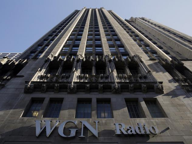 Tribune Media, which owns WGN Radio in Chicago, is suing Sinclair Broadcast Group over the way it handled divesting TV stations ahead of their planned merger.