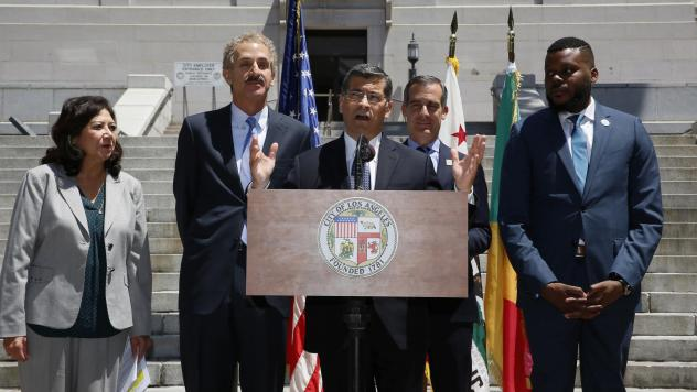 California Attorney General Xavier Becerra (center) announces that Stockton, Calif., and the city and county of Los Angeles are joining California's lawsuit over the 2020 census citizenship question at a news conference in Los Angeles in May. Becerra is