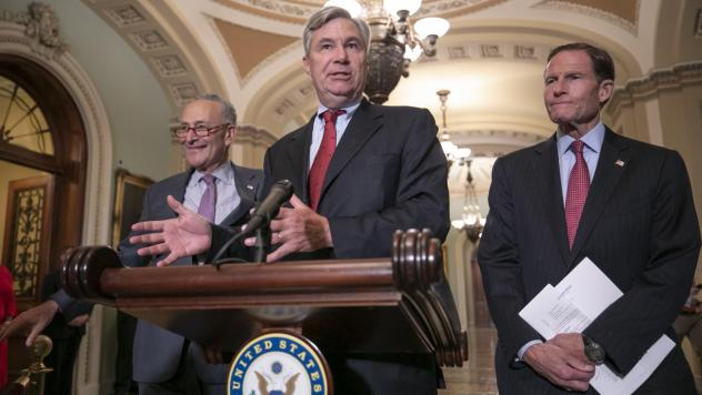 Sen. Sheldon Whitehouse, D-R.I., flanked by Senate Minority Leader Chuck Schumer, D-N.Y. (left), and Sen. Richard Blumenthal, D-Conn., at a news conference Thursday, where they said they will sue the National Archives if they don't get the documents on S