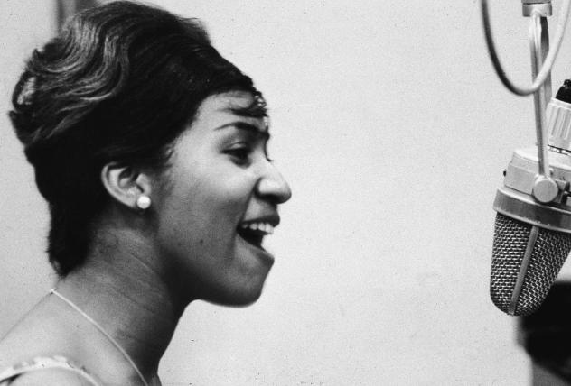 Aretha Franklin sings in the studio during during her early career at Columbia Records.