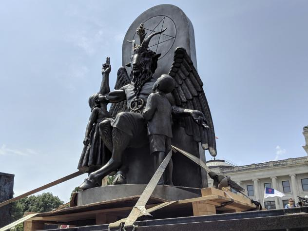 The Satanic Temple unveils its statue of Baphomet, a winged-goat creature, at a rally in Little Rock, Ark., Thursday. The group wants to install the statue on Capitol grounds because a monument of the Ten Commandments was placed there in 2017.