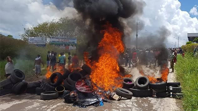 Residents of the Brazilian border town of Pacaraima burn tires and belongings of Venezuelan immigrants, after an attack on their makeshift camps.