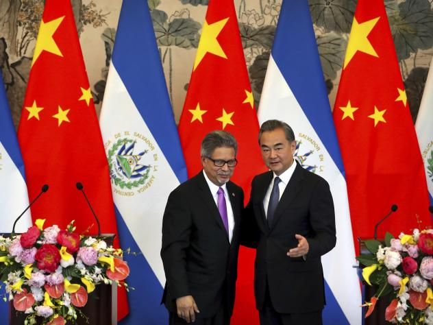 El Salvador's Foreign Minister Carlos Castaneda, left, and China's Foreign Minister Wang Yi stand together at a ceremony in Beijing to mark the beginning of diplomatic relations between the two countries on Tuesday. The move leaves Taiwan with one less a