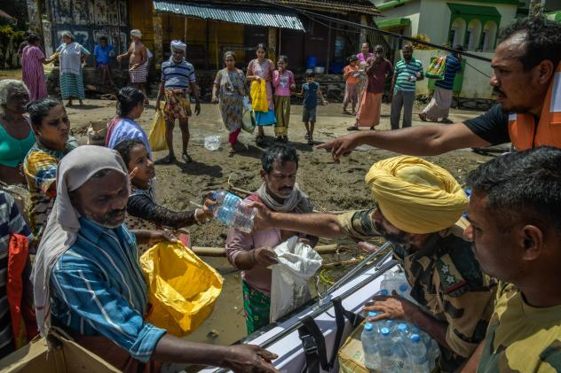 The Border Security Force distributes food and water in the aftermath of the flooding in Kerala. Online volunteers helped find out what people needed to get by — and shared public health messages.