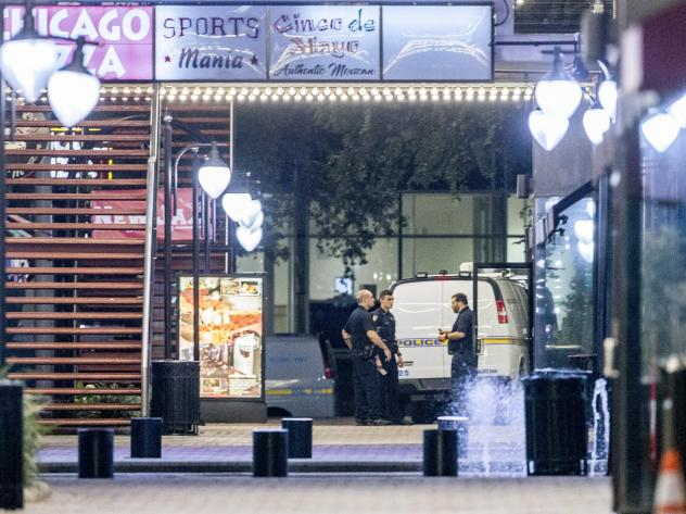 A heavy police presence remains into the night at the shooting inside Jacksonville Landing on Sunday in Jacksonville, Florida.