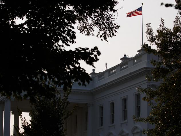 This combination of pictures created on Monday shows the U.S. flag above the White House.