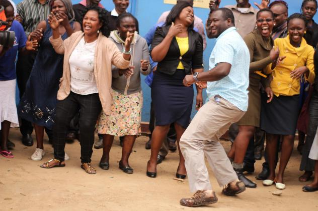 Kennedy Odede (in blue shirt) is dancing for a good reason. The charity he and his wife started has been awarded the $2 million Hilton Humanitarian Prize. He's joined by residents of Kibera, the neighborhood in Nairobi where his nonprofit group provides