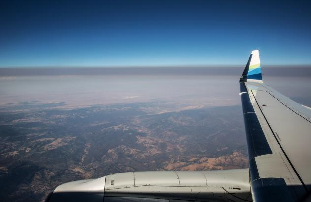 A thick layer of smoke from the Carr Fire settles over California's Central Valley in a view from a jet earlier this summer. Fine particulate matter from drifting wildfire smoke mixes with industrial ozone and can become trapped between the mountain rang