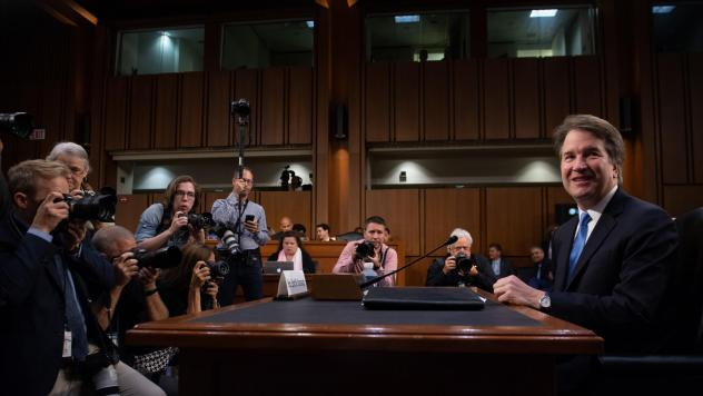 Kavanaugh looks over his notes while testifying on Thursday.