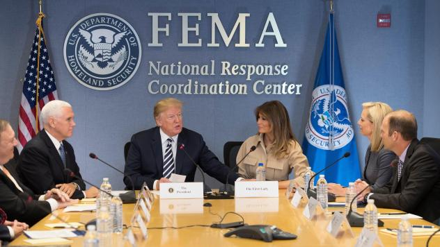 President Trump, Vice President Pence and first lady Melania Trump visit the Federal Emergency Management Agency headquarters in Washington, D.C., on June 6. Secretary of Homeland Security Kirstjen Nielsen and FEMA Administrator Brock Long are seated at
