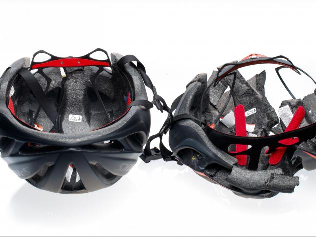 After testing a counterfeit helmet to see how well it handles a direct impact, Clint Mattacola of Specialized Bicycles holds the results — the fake helmet split in half. If a person had been wearing it, they could have suffered brain damage or death, h
