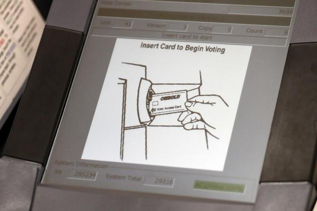 A touchscreen voting machine in Sandy Springs, Ga., during the primary election in May 2018. As the midterm congressional primaries heat up amid warnings of Russian hacking, about 1 in 5 Americans will be casting their ballots on machines that do not pro