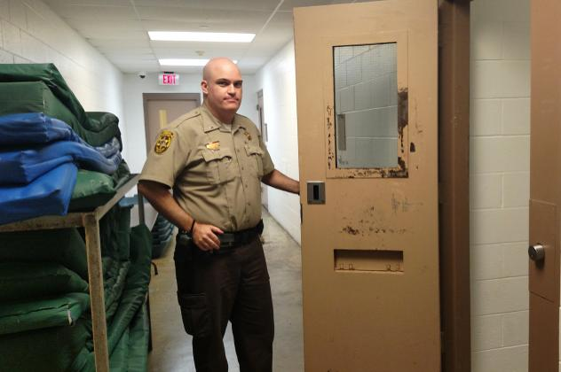 A cell in the Champaign County Jail that's sometimes used to house inmates who are suicidal. For the inmates' own safety, jail officials say, they may be placed alone in the cell with nothing but a mat and a garment that cannot be used to cause self-harm