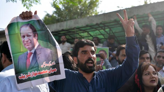 Pakistani supporters of ousted Prime Minister Nawaz Sharif carry posters and banners outside the high court building in Islamabad on Wednesday as they celebrate his release from prison. Sharif is appealing the conviction, which followed a major corruptio