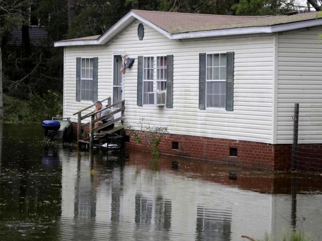 At a home not far from the Neuse River in New Bern, N.C., floodwaters last weekend overwhelmed the high-priced vehicles out front. According to consumer advocates, low-income homeowners stand to lose the most from changes expected in the insurance indust