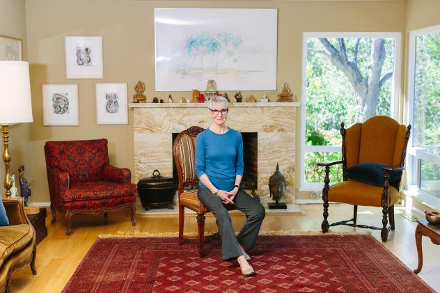 Jean Couch, 75, perches on the edge of a chair at her home in Los Altos Hills, Calif. She teaches people the art of sitting in chairs without back pain.